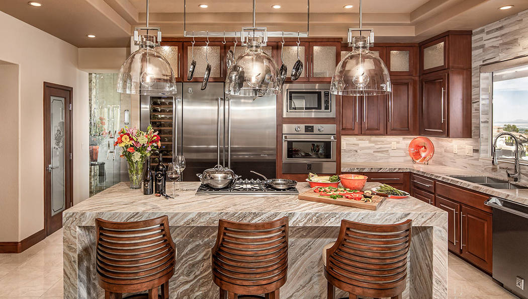 The kitchen has fine details, such as special lighting. (David Reisman Real Estate Millions)