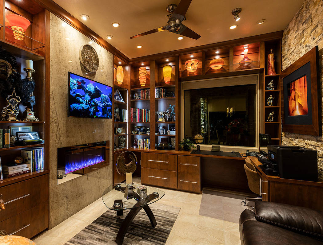Instead of the 350-gallon freshwater fish tank at their old home, there is a television set int ...