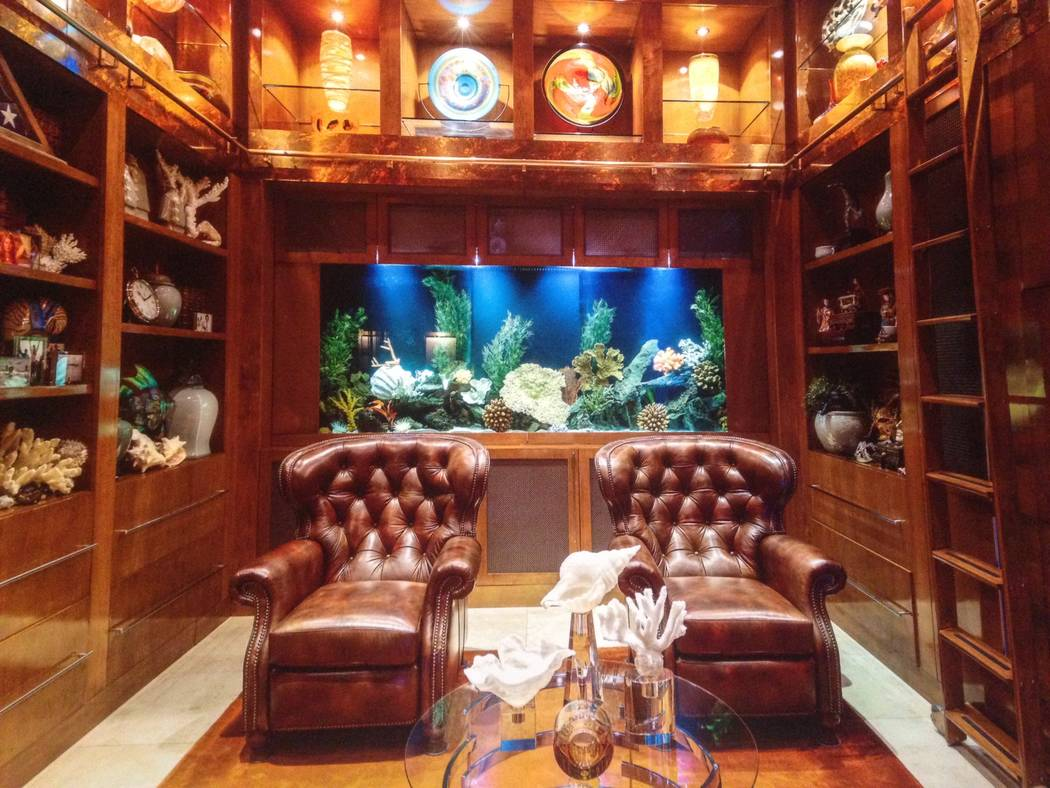 The Red Rock Country Club home has a 350-gallon freshwater fish tank built into the bookcase an ...