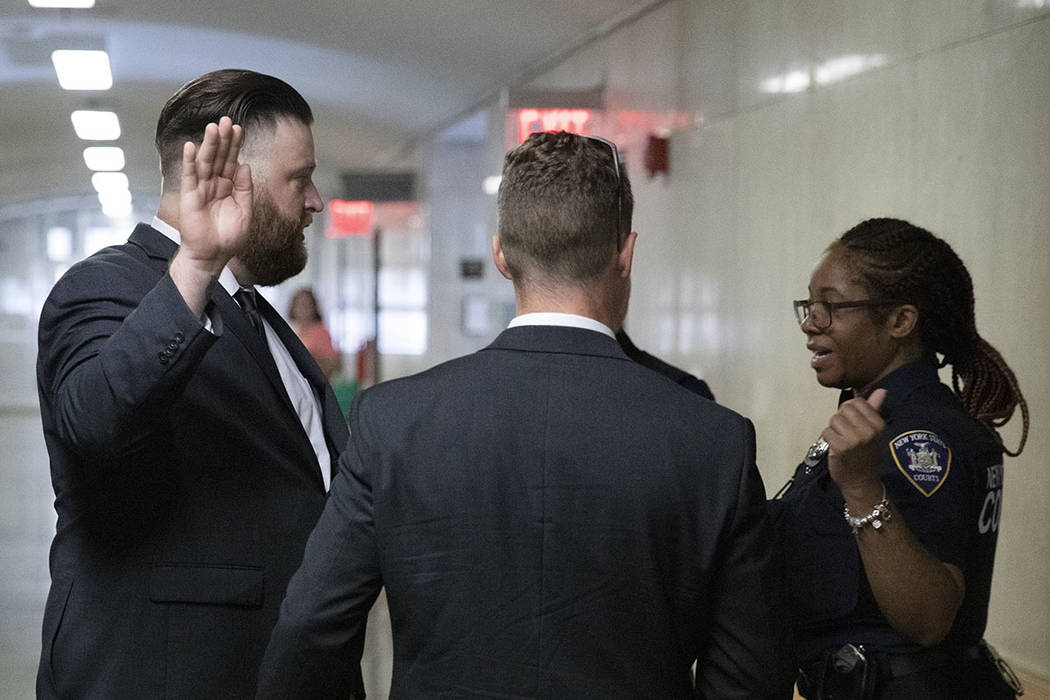 John Kinsman, left, and Maxwell Hare, center, talk with a court officer, Wednesday, July 31, 20 ...