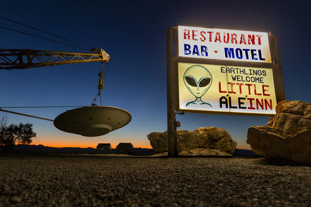 A spaceship hanging from a tow truck marks the entrance to the Little A'Le'Inn which is to be a ...