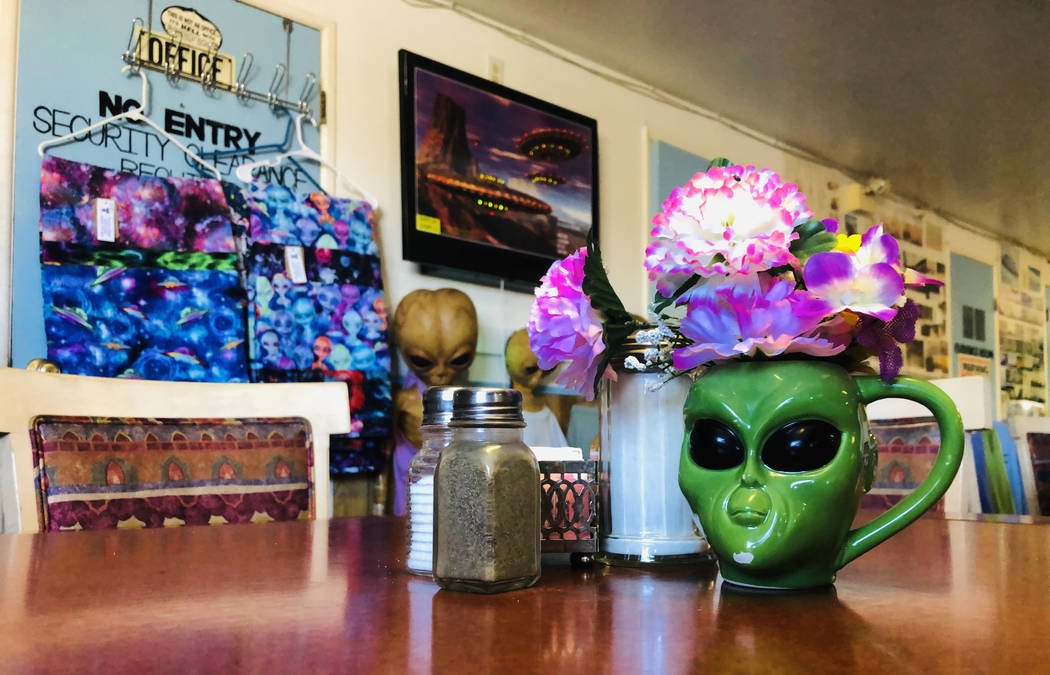 An alien mug is just one item amongst many depicting the creatures in the restaurant at the Lit ...