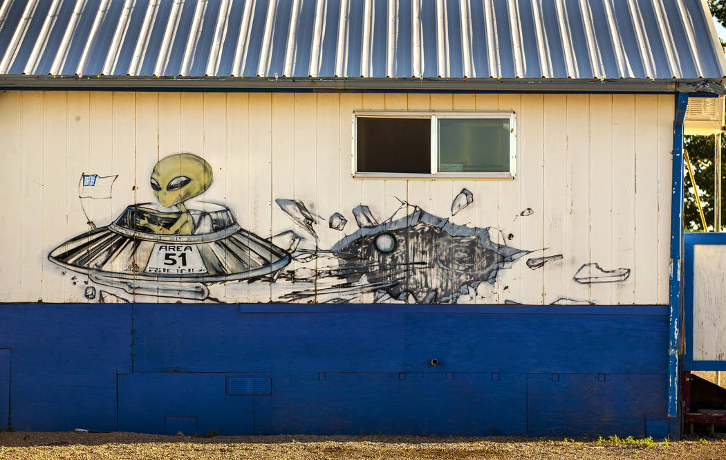 An alien flying in his spacecraft is depicted on the outside of the restaurant at the Little A ...