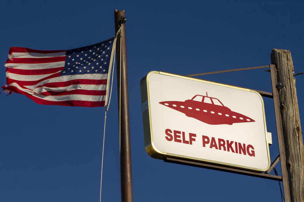 A UFO sign and American flag above the restaurant at the Little A'Le'Inn which is to be a gathe ...