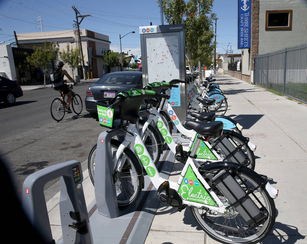 E-bikes for rent with traditional bikes at the Regional Transportation Commission bike share ra ...