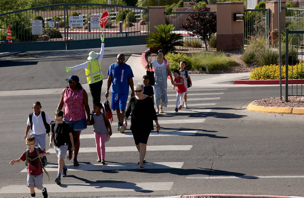 Parents take their children to school at Staton Elementary School in Las Vegas Tuesday, Aug. 20 ...