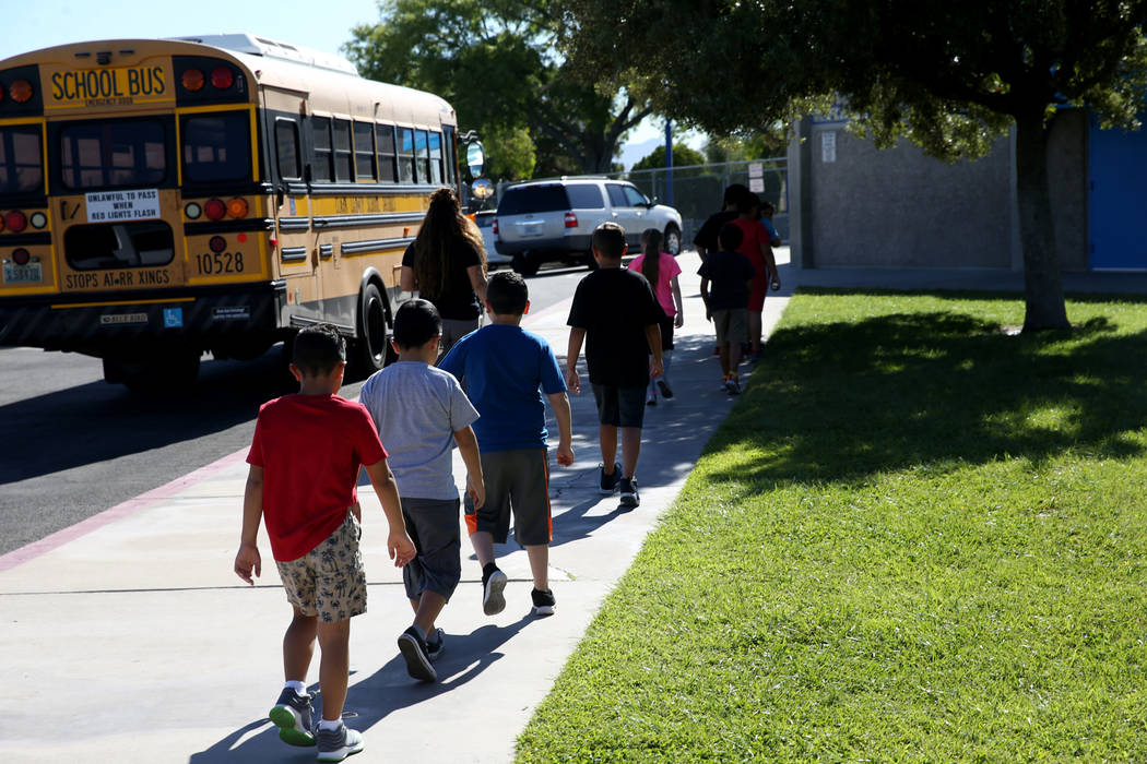 Helen Smith Elementary line up in front of their Las Vegas school, Tuesday, Aug. 20, 2019. (K.M ...