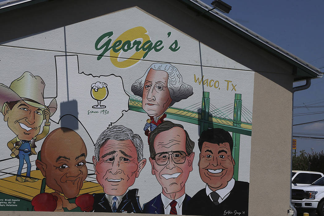 In this Aug. 17, 2019 photo, a Texas restaurant called George's that features a mural honoring ...