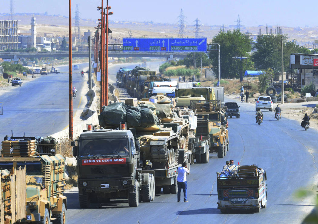 A Turkey Armed Forces convoy is seen at a highway between Maaret al-Numan and Khan Sheikhoun in ...