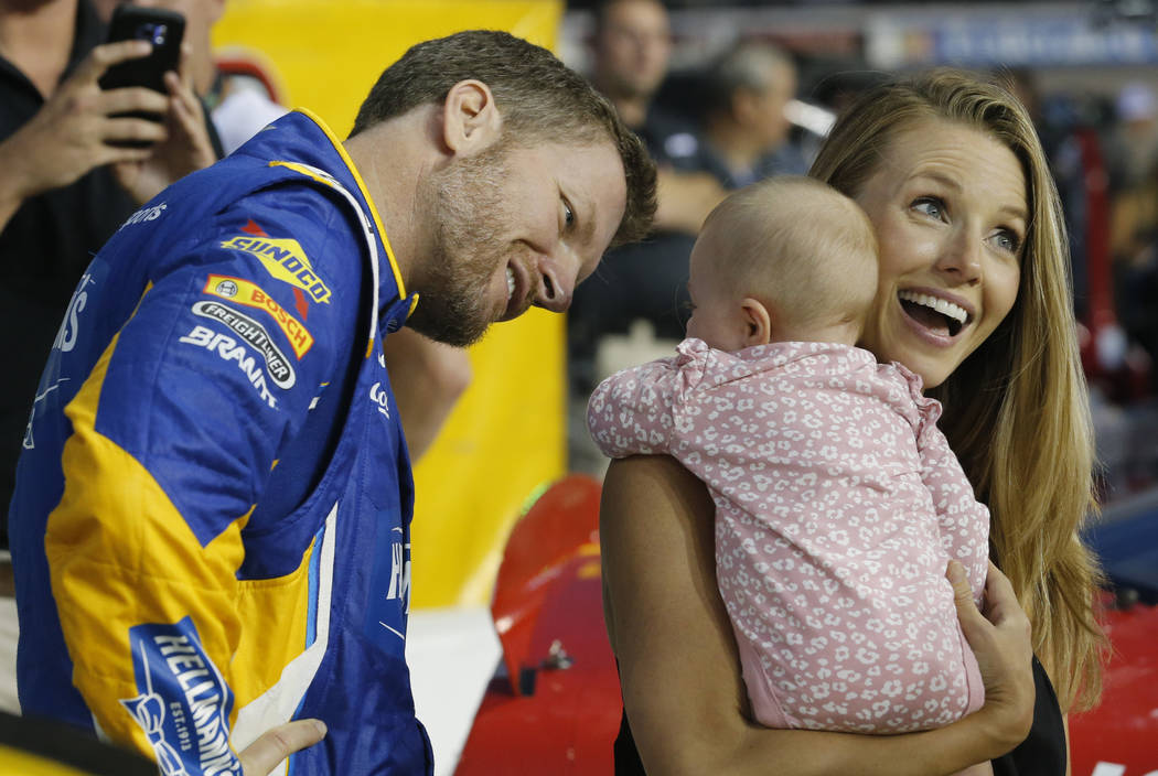 FILE - In this Sept. 21, 2018, file photo, Dale Earnhardt Jr. looks at his daughter, Isla, and ...