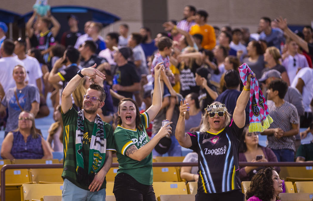 Fans cheer for free merchandise during the Las Vegas Lights FC versus Portland Timbers 2 match ...