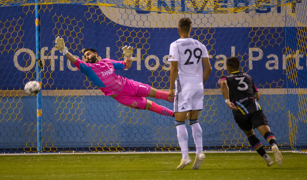 Las Vegas Lights FC goalkeeper Thomas Olsen (1) deflects another shot on goal as Portland Timbe ...