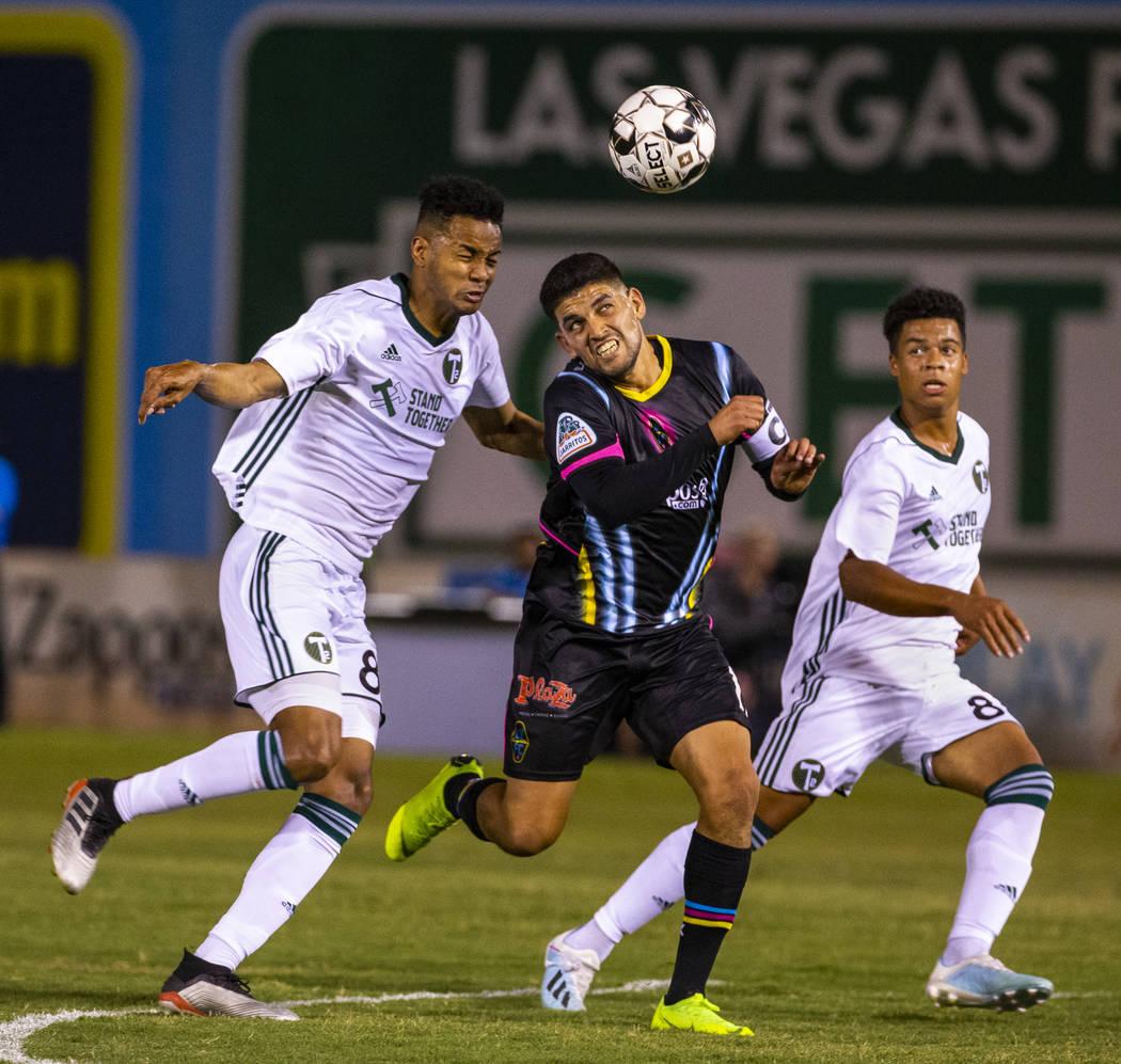 Las Vegas Lights FC forward Irvin Parra (11, center) heads the ball towards the goal between Po ...
