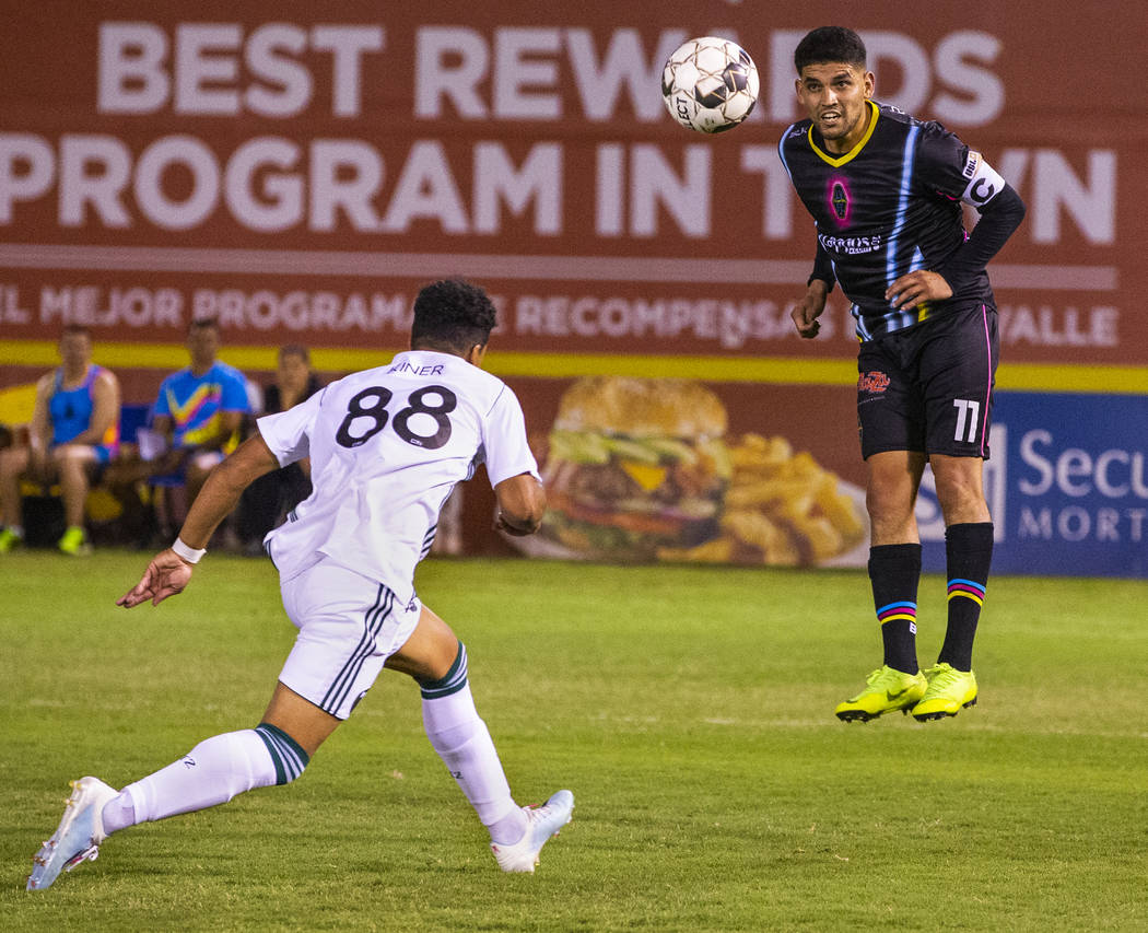 Las Vegas Lights FC forward Irvin Parra (11, right) heads the ball towards a teammate past Port ...
