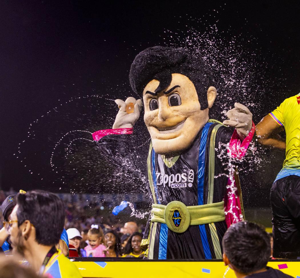Las Vegas Lights FC mascot Cash the Soccer Rocker is pelted by fans on field during a massive w ...