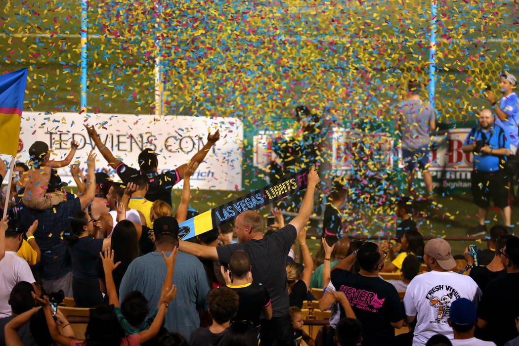 Las Vegas Lights FC fans are bathed in confetti as they celebrate their 1-0 win over Portland T ...