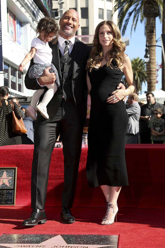 FILE - In this Dec. 13, 2017, file photo Lauren Hashian, right, Dwayne Johnson and their daught ...
