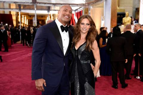 FILE - In this Feb. 22, 2015, file photo Dwayne Johnson, left, and Lauren Hashian arrive at the ...