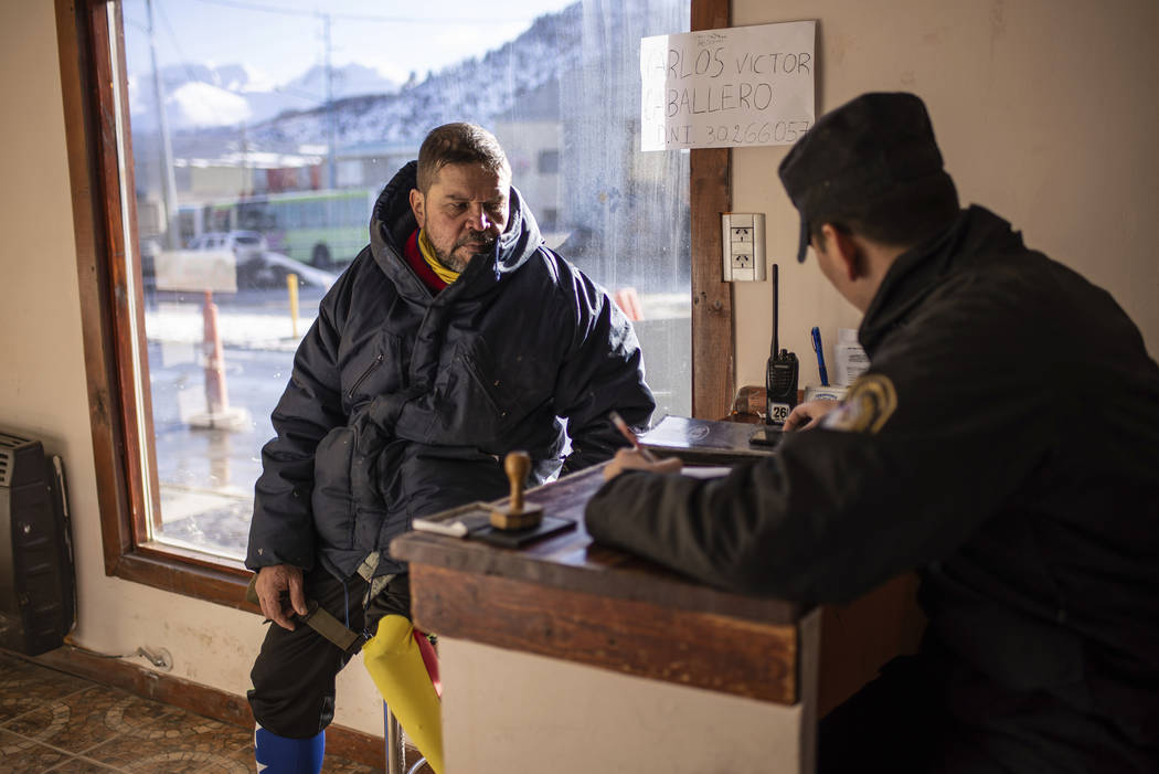 Venezuelan Yeslie Aranda registers his arrival at a police police station in Ushuaia, Argentina ...