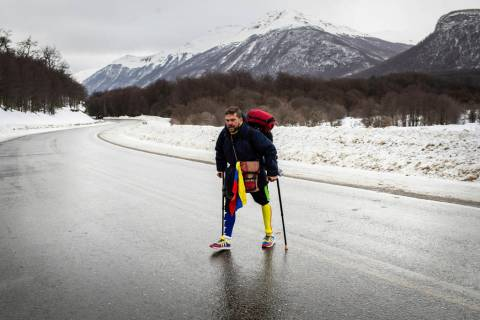 Venezuelan Yeslie Aranda, 57, walks on Route 3 between Tolhuin and Ushuaia, Argentina, Saturday ...