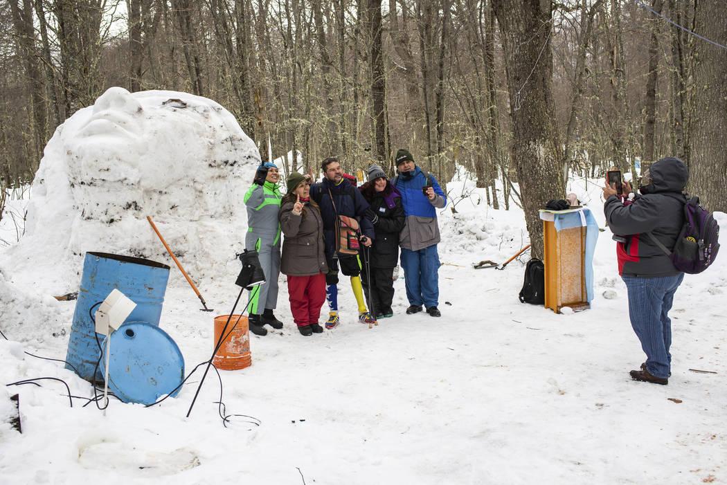Venezuelan Yeslie Aranda, 57, poses with a group of ice artisans at the Haruwen Winter Center o ...