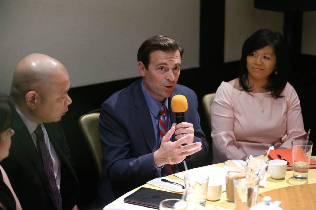 Former Nevada Attorney General Adam Laxalt, center, with Sonny Vinuya, left, president for the ...