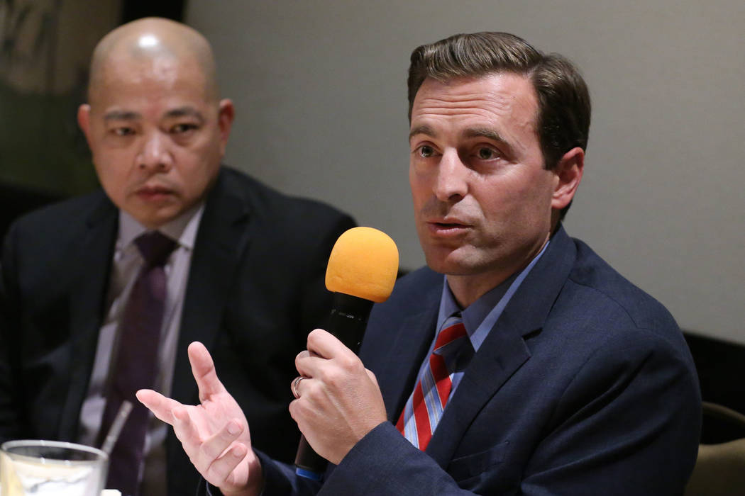 Former Nevada Attorney General Adam Laxalt, right, with Sonny Vinuya, president for the Asian C ...
