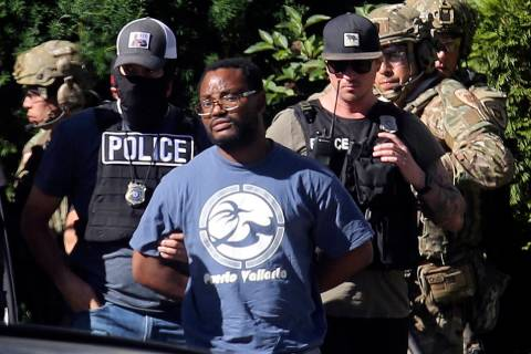 In a June 28, 2019, file photo, Salt Lake City police take Ayoola A. Ajayi into custody in conn ...