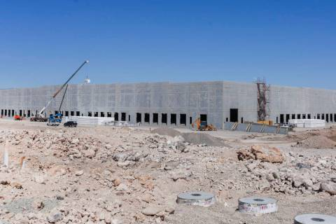 An industrial building, slated to be a future Amazon distribution facility, is under constructi ...