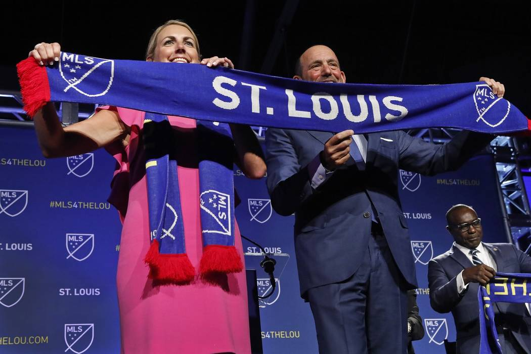 Carolyn Kindle Betz, a member of the ownership group of the new soccer franchise, and Major Lea ...