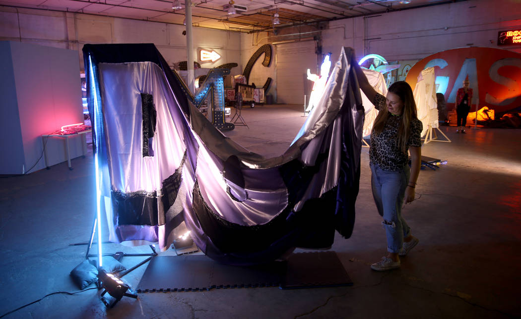 Julie Henson, artist in residence for the Neon Museum, works on one of her sculptures at the mu ...