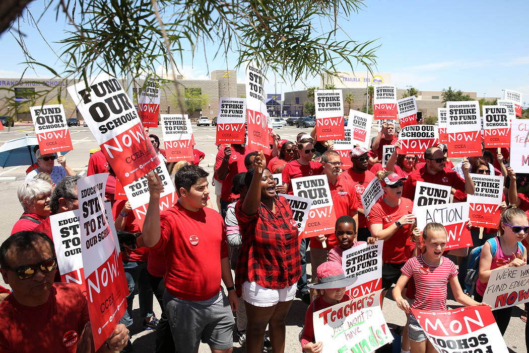 Members and supporters of the Clark County Education Association protest in front of Durango Hi ...