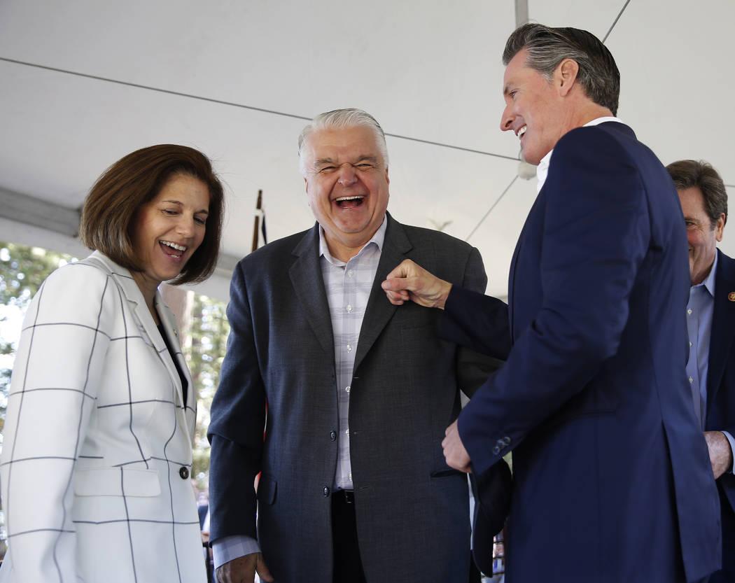 California Gov. Gavin Newsom, right, has a light-hearted moment with Nevada Gov. Steve Sisolak, ...