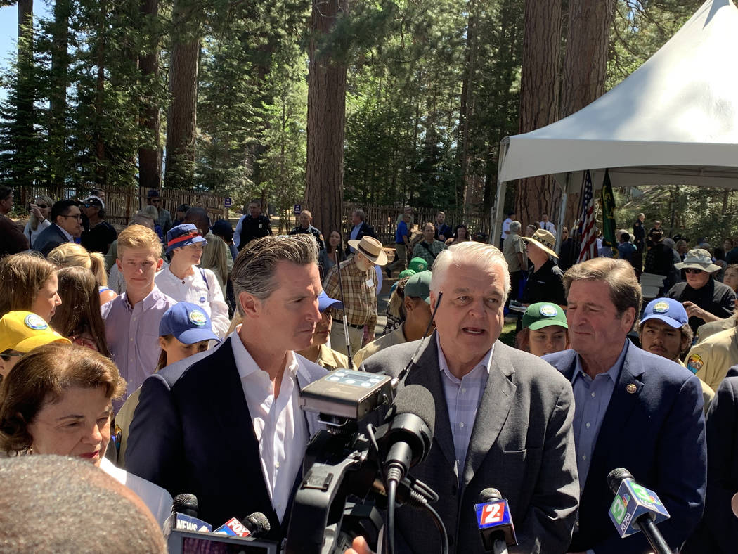 Govs. Gavin Newsom of California, left, and Steve Sisolak of Nevada speak to reporters followin ...