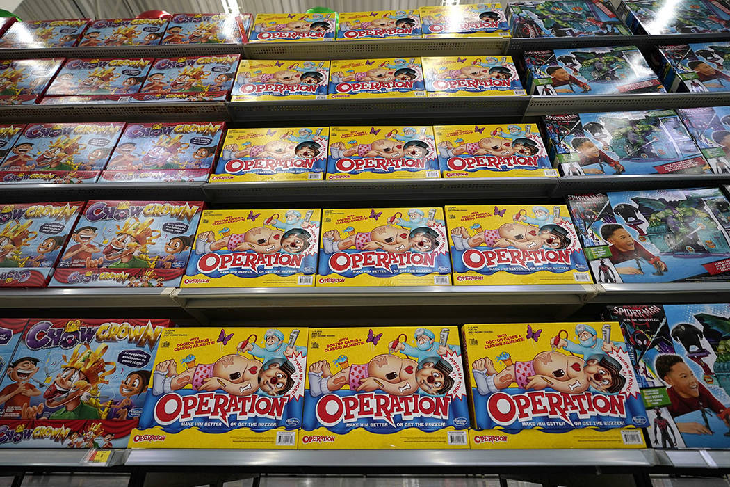 FILE- In this Nov. 9, 2018, file photo Operation made by Hasbro is displayed shelves in the exp ...
