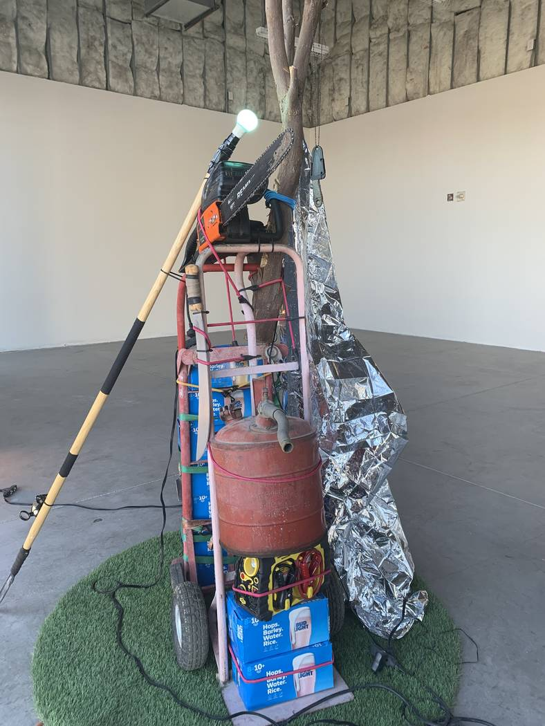 One of Fathollahi's sculptures is composed of a variety of survival objects including a spear, ...