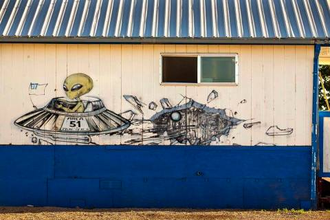 An alien flying in his spacecraft is depicted on the outside of the restaurant at the Little A' ...