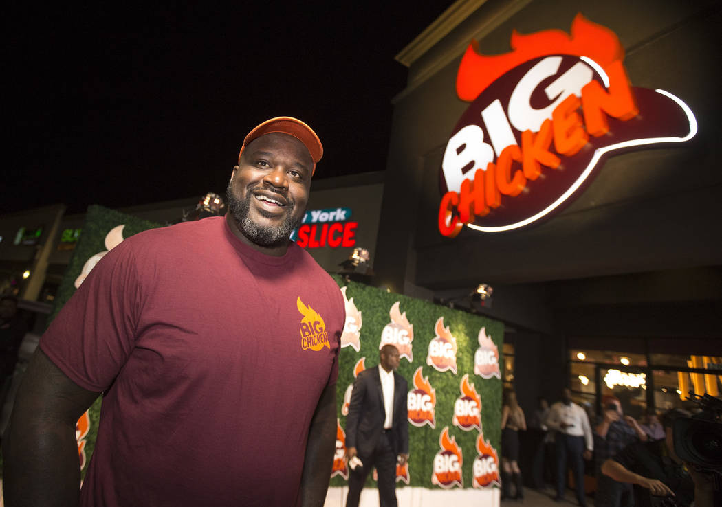 Shaquille O'Neal smiles during the grand opening celebration of Big Chicken, Shaq's fast-casual ...