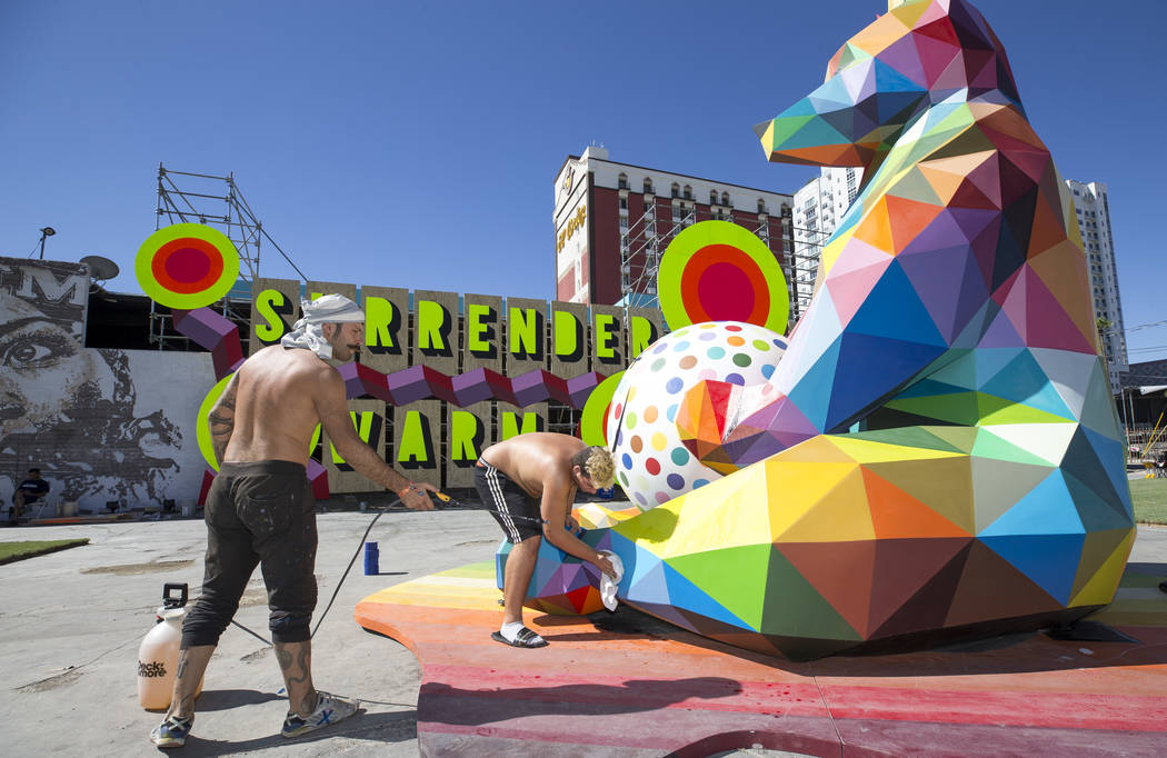 Pablo Hattori, left, and Marcos Martinez, assistants to Spanish street artist Okuda San Miguel, ...