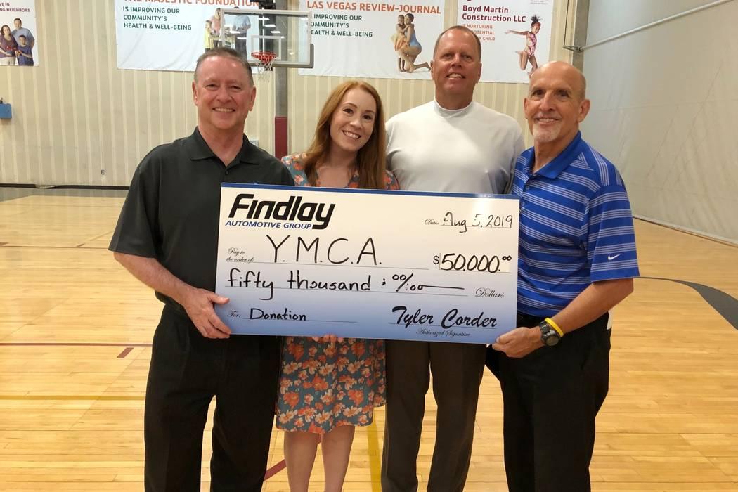 Findlay Automotive Group CFO Tyler Corder, left, provided a donation of $50,000 to YMCA of Sou ...