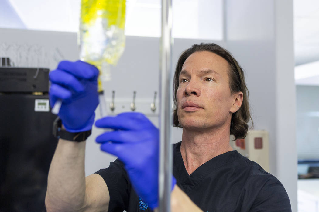 Dr. Jason Burke, founder of pioneering IV-therapy business Hangover Heaven, prepares IV fluids ...
