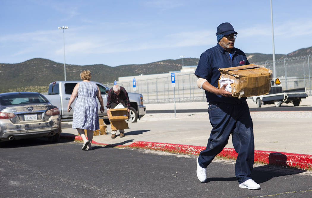 Paul Browning moves boxes full of paperwork to a car after being released from Ely State Prison ...