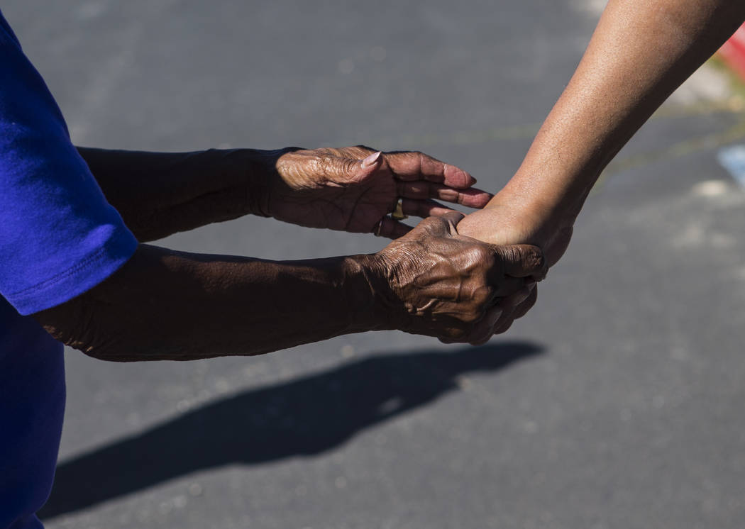 Betty Browning, left, holds the hand of her son Paul after he was released from Ely State Priso ...