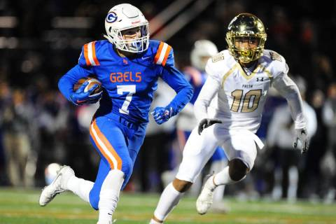 Bishop Gorman running back Biaggio Ali Walsh (7) rushes for a touchdown as Faith Lutheran Faith ...