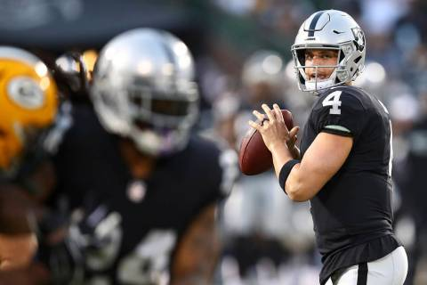 Oakland Raiders quarterback Derek Carr (4) looks for a receiver during the first half of the te ...