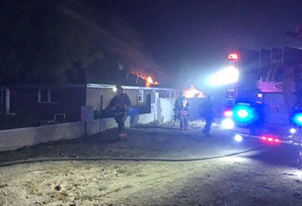 Las Vegas firefighters at the scene of a house fire at 3011 Alta Drive on Wednesday, Aug. 21, 2 ...