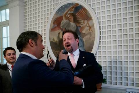 Radio host Sebastian Gorka, right, speaks with Playboy's Brian Karem, center, after President D ...