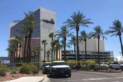 Las Vegas police guard the perimeter of Aquarius Casino in Laughlin after an officer-involved s ...