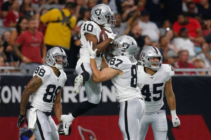 Oakland Raiders wide receiver Rico Gafford (10) celebrates his touchdown against the Arizona Ca ...