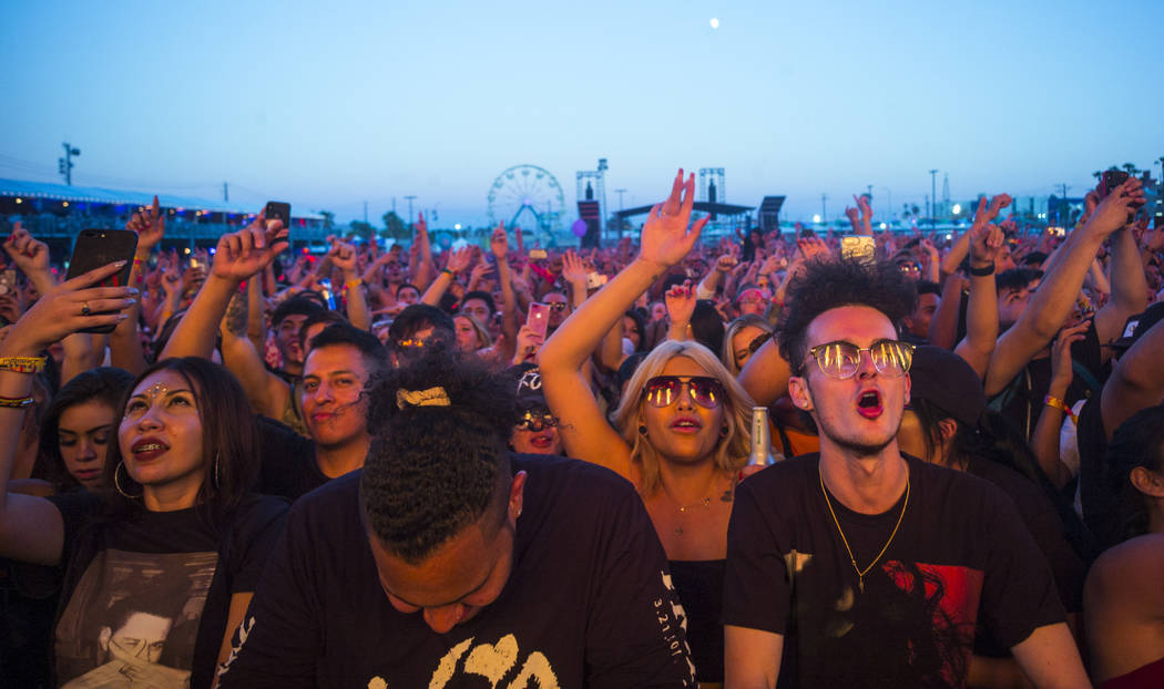 Fans react as French Montana performs at the Downtown stage during the first day of the annual ...